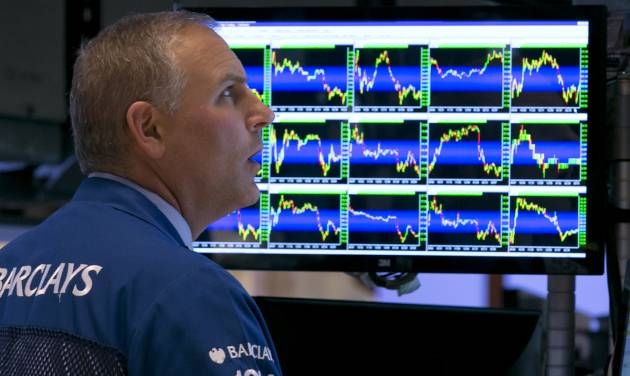 Specialist Geoffrey Friedman works at his post on the floor of the New York Stock Exchange, Tuesday, Aug. 5, 2014. The stock market fell to its lowest point since May as traders worried that tensions between Russia and Ukraine could flare up. (AP Photo/Richard Drew)