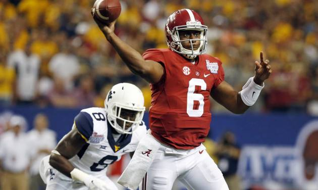 Alabama quarterback Blake Sims (6) throws under pressure from West Virginia safety Karl Joseph (8) during the first half of an NCAA college football game Saturday, Aug. 30, 2014, in Atlanta.  (AP Photo/ Brynn Anderson)