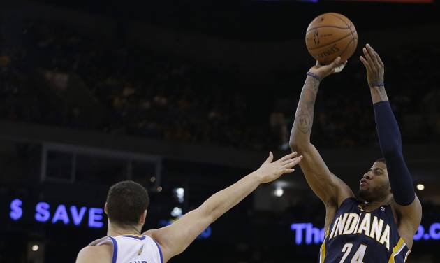 Indiana Pacers' Paul George (24) shoots over Golden State Warriors' Klay Thompson during the second half of an NBA basketball game Monday, Jan. 20, 2014, in Oakland, Calif. (AP Photo/Ben Margot)