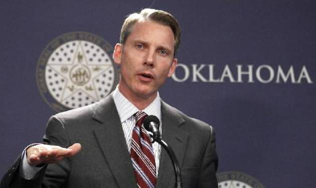 Oklahoma state Treasurer Ken Miller, seen in this AP file photo, gestures during a news conference in Oklahoma City, Tuesday, April 3. Miller, who holds a doctorate in economics, has expressed confusion over the state income tax reduction passed in the last legislative session. (AP Photo/Sue Ogrocki)