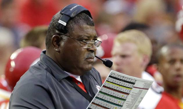 FILE - In this Aug. 24, 2012, file photo, Kansas City Chiefs head coach Romeo Crennel looks at his notes during the first half of an NFL preseason football game against the Seattle Seahawks in Kansas City, Mo. League violations and injuries have put a damper on the Chiefs' optimism heading into the upcoming season, but an offense that has shown signs of brilliance is giving folks around Arrowhead Stadium the confidence to talk playoffs. The Chiefs are scheduled to begin their regular season on Sept. 9 at home against the Atlanta Falcons. (AP Photo/Charlie Riedel, File)