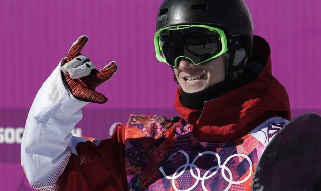 Canada's Maxence Parrot reacts after a run during the men's snowboard slopestyle qualifying at the Rosa Khutor Extreme Park ahead of the 2014 Winter Olympics, Thursday, Feb. 6, 2014, in Krasnaya Polyana, Russia.  (AP Photo/Andy Wong)