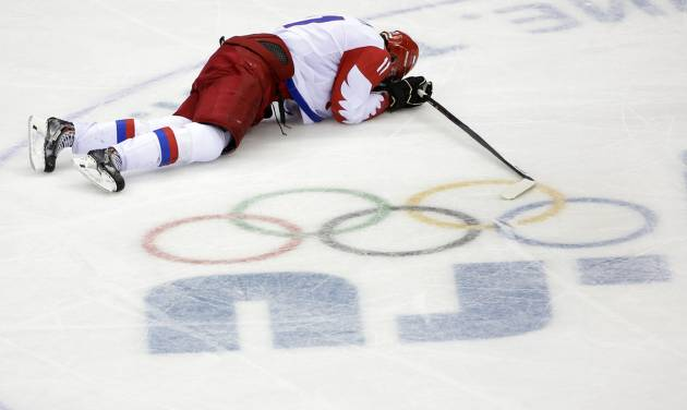 Russia forward Yevgeni Malkin lies on the ice in the closing minutes of the third period in men's quarterfinal hockey game against Finland at Bolshoy Arena at the 2014 Winter Olympics, Wednesday, Feb. 19, 2014, in Sochi, Russia. Finland defeated Russia 3-1. (AP Photo/David J. Phillip )