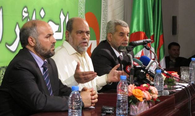 Leader of the Islamist Movement of Society for Peace Party, Abou Djara Soltani, center, expresses dissatisfaction on Friday May 11, 2012 with the results announced by the government of Algeria's legislative elections while flanked by fellow Islamist leaders of the Green Alliance, Faleh Rebai on the left, Hamlaoui Akouchi on the right. According to government results, the two government-linked parties dominated Algeria's election, taking an absolute majority. (AP Photo/Paul Schemm).
