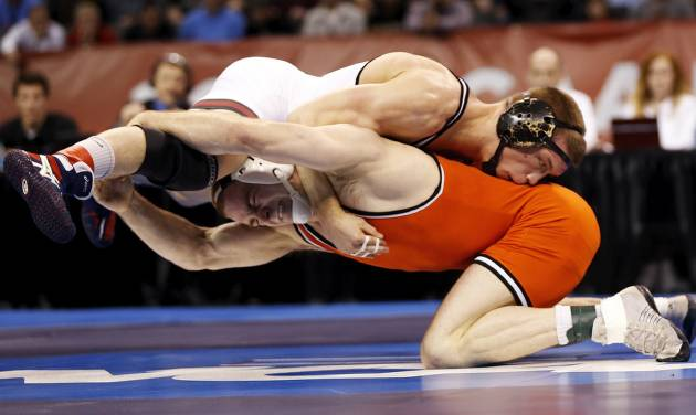 OSU's Chris Perry, bottom, and OU's Andrew Howe wrestle in the 174-pound championship match  in the 2014 NCAA Div. I Wrestling Championships at Chesapeake Energy Arena in Oklahoma City, Saturday, March 22, 2014. Photo by Nate Billings, The Oklahoman