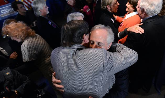 Sen. Bob Corker, R-Tenn., is greeted by several of his supporters after speaking at his election night victory rally at the Cabana Restaurant on Tuesday, Nov. 6, 2012, in Nashville, Tenn. (AP Photo/Mark Zaleski)