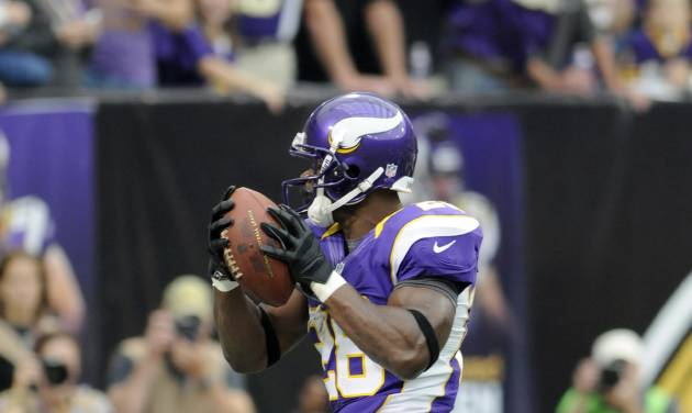 Minnesota Vikings running back Adrian Peterson leaps to the end zone as he scores a touchdown during the first half of an NFL football game against the Jacksonville Jaguars, Sunday, Sept. 9, 2012, in Minneapolis. (AP Photo/Jim Mone)