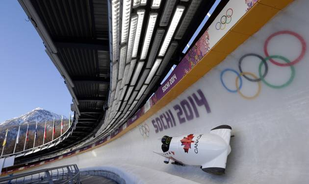 The CAN-2 sled from Canada takes a turn during a training run for the two-man bobsled at the 2014 Winter Olympics, Thursday, Feb. 6, 2014, in Krasnaya Polyana, Russia. (AP Photo/Michael Sohn)