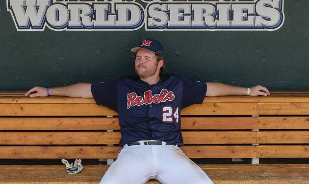 CORRECTS ID TO SIKES ORVIS NOT COLBY BORTLES - Mississippi's Sikes Orvis (24) sits in the dugout after a 4-1 loss to Virginia in an NCAA College World Series baseball game in Omaha, Neb., Saturday, June 21, 2014. Virginia advances to the championship series and Mississippi is eliminated. (AP Photo/Eric Francis)