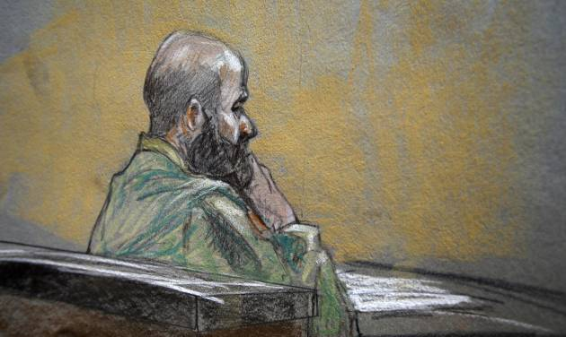 In this courtroom sketch, U.S. Army Maj. Nidal Malik Hasan is shown during closing arguments of his court martial,  Thursday Aug. 22, 2013, in Fort Hood, Texas. (AP Photo/Brigitte Woosley)