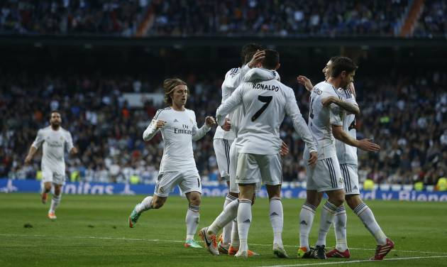 Real's Cristiano Ronaldo, center, celebrates his goal with teammates during a Spanish La Liga soccer match between Real Madrid and Levante at the Santiago Bernabeu stadium in Madrid, Spain, Sunday March 9, 2014. (AP Photo/Andres Kudacki)