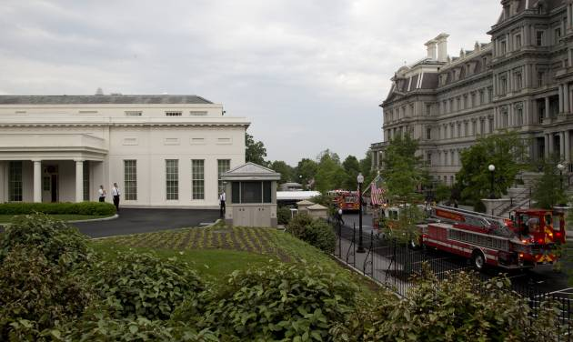 District of Columbia Fire department trucks and personnel respond to a call at the White House, Saturday, May 11, 2013, in Washington. The West Wing including the media area were evacuated because of smoke, according to Secret Service Uniformed Division.  journalists were sent outside shortly after 7 a.m. while firefighters inspected the West Wing. They were allowed back into the building about an hour later. (AP Photo/Carolyn Kaster)