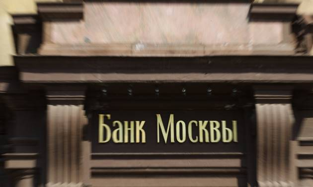 "Sign reading 'Bank of Moscow"" is installed on the headquarters of Russian Agricultural Bank in downtown Moscow, Russia, on Wednesday, July 30, 2014. The European Union approved dramatically tougher economic sanctions Tuesday against Russia, followed swiftly by a new round of U.S. penalties. Among the targets were three Russian banks: the Bank of Moscow, Russian Agricultural Bank and VTB Bank, Russia's second largest bank. (AP Photo/Ivan Sekretarev)"