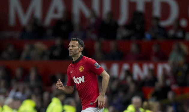 Manchester United's interim manager Ryan Giggs takes to the pitch as a substitute during his team's English Premier League soccer match against Hull at Old Trafford Stadium, Manchester, England, Tuesday May 6, 2014. (AP Photo / Jon Super)