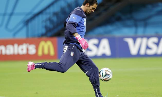 Italy's goalkeeper Gianluigi Buffon practices his goal kicks during a training session at Arena da Amazonia in Manaus, Brazil, Friday, June 13, 2014.  Italy plays in group D of the 2014 soccer World Cup. (AP Photo/Marcio Jose Sanchez)