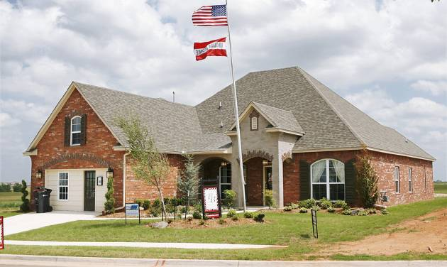 Flags fly over the Brass Brick Design/Build model home at 3260 Orchard Ave. in The Grove addition at NW 192 and May Avenue.PHOTO BY JIM BECKEL, THE OKLAHOMAN