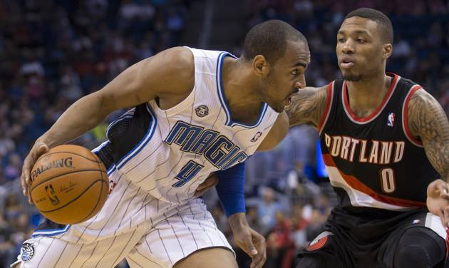 Orlando Magic's Arron Afflalo (4) takes the ball inside the key against Portland Trail Blazers' Damian Lillard (0) during the first half of an NBA basketball game in Orlando, Fla., Tuesday, March 25, 2014. (AP Photo/Willie J. Allen Jr.)