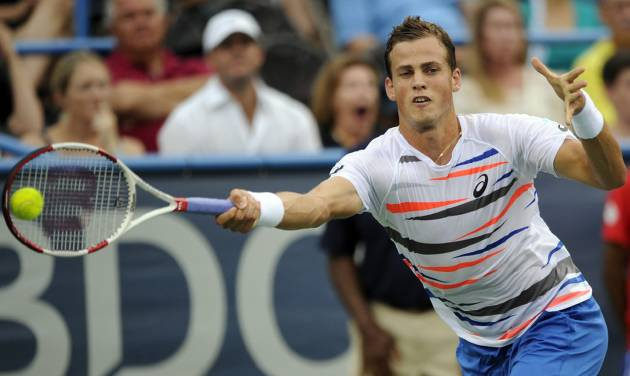 Vasek Pospisil, of Canada, reaches for the ball against Richard Gasquet, of France, during a match at the Citi Open tennis tournament, Saturday, Aug. 2, 2014, in Washington. (AP Photo/Nick Wass)
