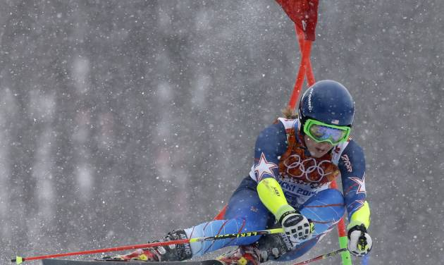United States' Mikaela Shiffrin passes a gate in the second run of the women's giant slalom at the Sochi 2014 Winter Olympics, Tuesday, Feb. 18, 2014, in Krasnaya Polyana, Russia. (AP Photo/Luca Bruno)