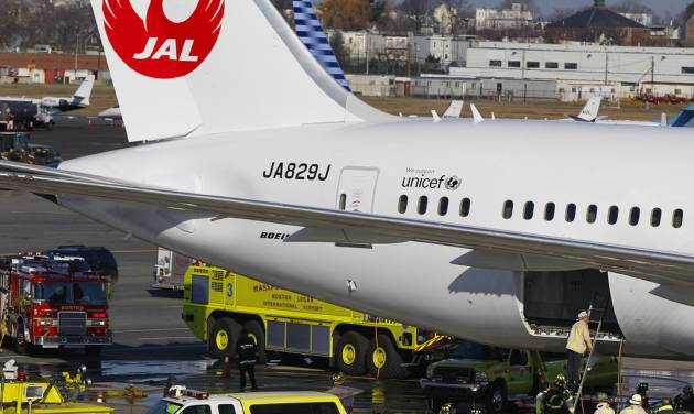 FILE - In this Jan. 7, 2013, file photo, a Japan Airlines Boeing 787 jet aircraft is surrounded by emergency vehicles while parked at a terminal E gate at Logan International Airport in Boston as a fire chief looks into the cargo hold. The FAA failed to properly test the Boeing 787's lithium-ion batteries and relied too much on Boeing for technical expertise, a new report from the National Transportation Safety Board says Thursday, May 22, 2014. (AP Photo/Stephan Savoia, File)
