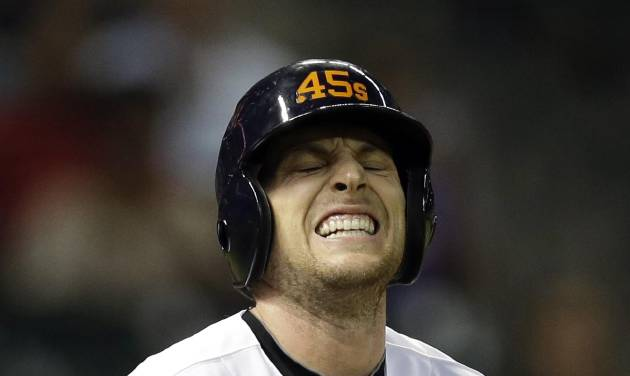 Houston Astros shortstop Jed Lowrie reacts after being hit by a pitch during the sixth inning of a baseball game against the Pittsburgh Pirates, Friday, Sept. 21, 2012, in Houston. (AP Photo/David J. Phillip)