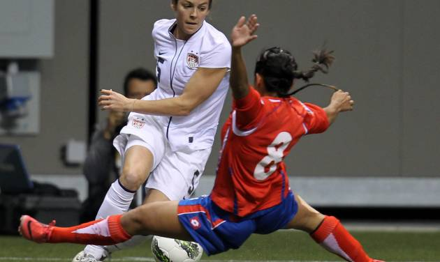 FILE - In this Jan. 27, 2012, file photo, United States' Kelly O'Hara (5) fights for control of the ball with Costa Rica's Daniela Cruz (8) during the first half of CONCACAF women's Olympic qualifying soccer game action at B.C. Place in Vancouver, British Columbia. A group of players from the U.S. women's national team, who will vie for a spot in the World Cup in October qualifying, have joined with several international players in protesting the turf surfaces for next summer's big event in Canada. (AP Photo/The Canadian Press, Jonathan Hayward, File)