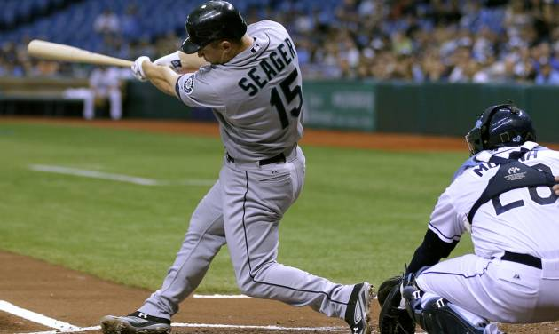 Seattle Mariners' Kyle Seager follows through on his first-inning, three-run home run off Tampa Bay Rays starting pitcher James Shields during a baseball game, Wednesday, May 2, 2012, in St. Petersburg, Fla. Mariners' Ichiro Suzuki and Jesus Montero also scored on the hit. Catching for Tampa Bay is Jose Molina. (AP Photo/Chris O'Meara)