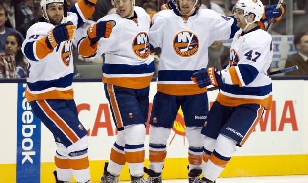 From left, New York Islanders' Frans Nielsen, Travis Hamonic, Michael Grabner and Andrew MacDonald celebrate a goal against the Toronto Maple Leafs during the third period of their NHL hockey game, Thursday, Jan. 24, 2013, in Toronto. The Islanders won 7-4. (AP Photo/The Canadian Press, Frank Gunn)