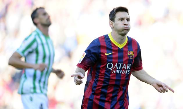 FC Barcelona's Lionel Messi gestures after scoring during a Spanish La Liga soccer match against Betis at the Camp Nou stadium in Barcelona, Spain, Saturday, April 5, 2014. (AP Photo/Manu Fernandez)