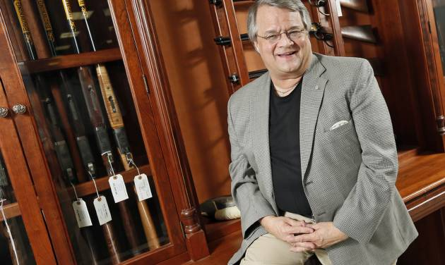 Miles Hall, co-owner of H&H Shooting Sports Complex, poses for a photo at his store, 400 S Vermont Avenue, Suite 110, in Oklahoma City, Wednesday, July 17, 2013. Photo by Nate Billings, The Oklahoman