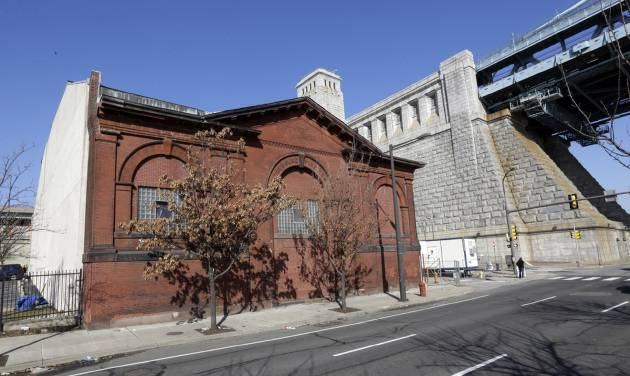 A historic pumping station at the base of the Benjamin Franklin Bridge is seen Monday, Feb. 25, 2013, in Philadelphia. Now in its 17th year, the Philadelphia Live Arts Festival and Philly Fringe is beginning a new chapter in the pumping station on the city's bustling waterfront. The new 10,000-square-foot home plans to feature a 240-seat theater, studio space, permanent festival hub, an outdoor plaza, offices and a restaurant/bar. (AP Photo/Matt Rourke)