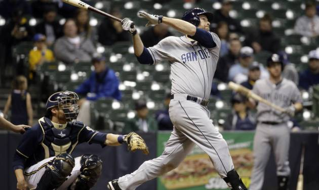 San Diego Padres' Chase Headley hits a home run during the 12th inning of a baseball game against the Milwaukee Brewers Tuesday, April 22, 2014, in Milwaukee. (AP Photo/Morry Gash)