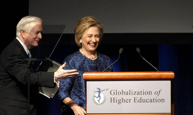 Former North Carolina Governor Jim Hunt thanks former first lady and U.S. Secretary of State Hillary Clinton after speaking at a conference on the globalization of higher education at Four Seasons Resort and Club Las Colinas in Irving, Texas, Monday, March 24, 2014. (AP Photo/The Dallas Morning News, Lara Solt)