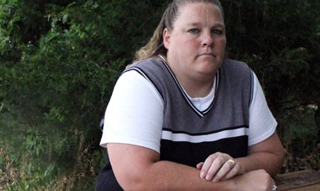 This undated photo shows Amy Miller of Eudora, Kan. The Kansas Supreme Court has upheld a state law imposing a $250,000 cap on damages that can be awarded for pain and suffering in personal injury lawsuits. The court ruled Friday, Oct. 5, 2012, against Miller, who challenged the 1988 law imposing the cap on non-economic damages. Miller sued her doctor for removing the wrong ovary from her during surgery in 2002. A jury awarded her nearly $760,000 in damages in 2006, but the award was reduced. (AP Photo/Lawrence Journal-World, Phi Cauthorn)