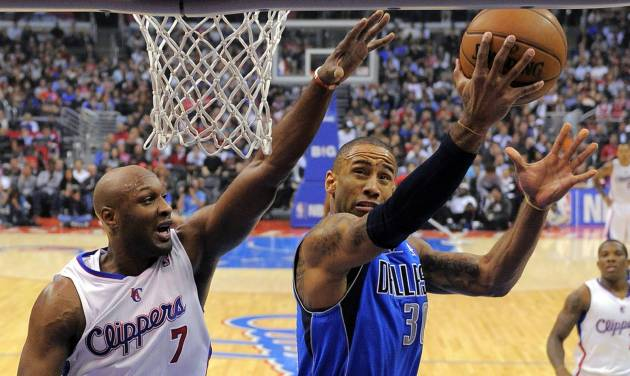 Dallas Mavericks guard Dahntay Jones, right, shoots as Los Angeles Clippers forward Lamar Odom defends during the first half of their NBA basketball game, Wednesday, Dec. 5, 2012, in Los Angeles. (AP Photo/Mark J. Terrill)