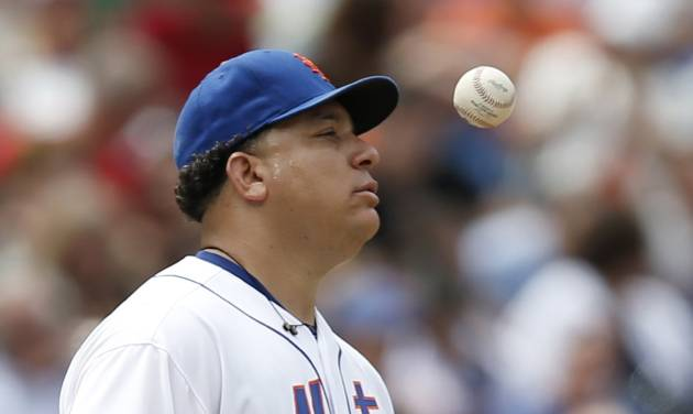 New York Mets starting pitcher Bartolo Colon reacts by tossing the ball before Mets manager Terry Collins took him out in the fifth inning of a baseball game against the San Francisco Giants in New York, Sunday, Aug. 3, 2014. (AP Photo/Kathy Willens)