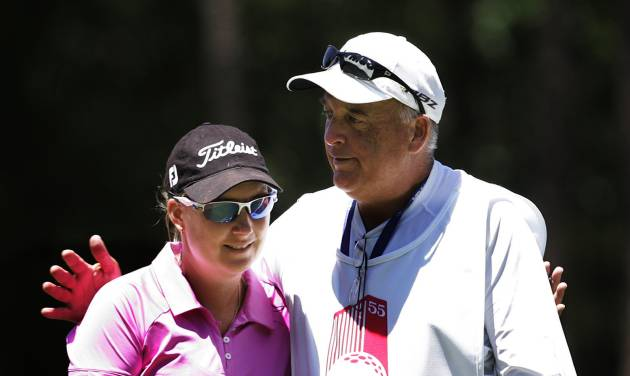 Lindsey Wright, left, is greeted by her caddie after finishing the first round of the Mobile Bay LPGA Classic golf tournament, Thursday April 26, 2012, in Mobile, Ala. (AP Photo/ Press-Register, Victor Calhoun) MAGS OUT