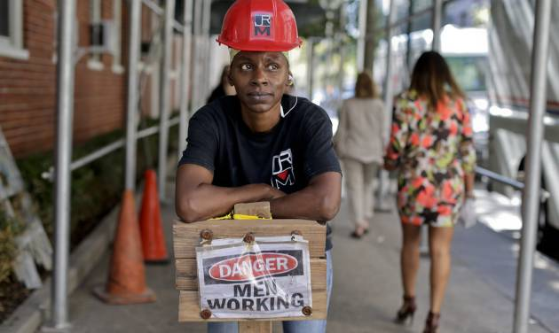 In this Aug. 14, 2014 photo, Sophia McIntosh stands for a photo outside a construction site where she works as a shop steward, in New York. The latest federal data shows about 7.1 million Americans were employed in construction-related occupations last year and only 2.6 percent were women. (AP Photo/Julie Jacobson)
