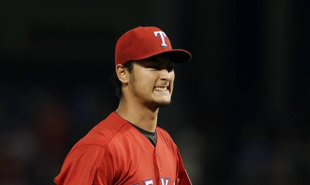 Texas Rangers' Yu Darvish of Japan grimaces after throwing a pitch for a ball against the Boston Red Sox in the seventh inning of a baseball game, Friday, May 9, 2014, in Arlington, Texas. The Japanese ace fell one out shy of a no-hitter for the second time Friday night, giving up only a ninth-inning single to David Ortiz in the Texas Rangers' 8-0 victory over the Red Sox. (AP Photo/Tony Gutierrez)