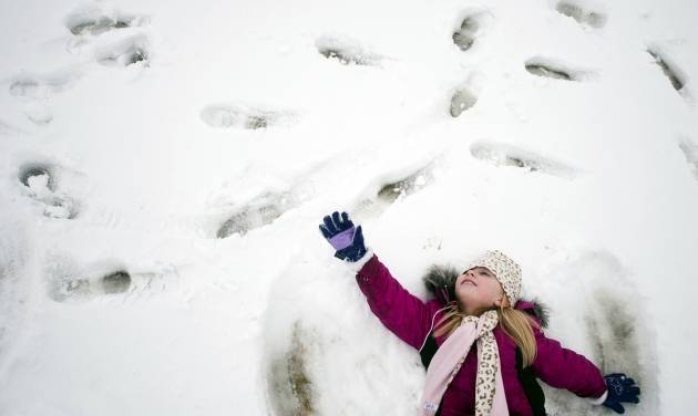 In a Feb. 28, 2013 photo, kindergartener Paige Chisholm, 6, makes a snow angel during at Cook Elementary School in Grand Blanc, Mich. Getting a snow day from school is a bonus for students, but not if they have too many in one year. Schools in northern Michigan may have to extend classes later into June as winter weather led to more cancellations than usual. A bill approved 34-1 Thursday by the Michigan Senate would let schools lengthen their days for the rest of the school year instead of having to make them up. (AP Photo/The Flint Journal, Jake May, FILE)