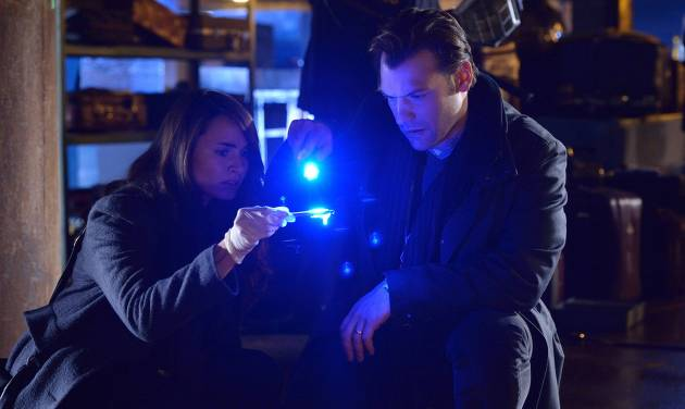 """This image released by FX shows Mia Maestro as Nora Martinez, left, and Corey Stoll as Ephraim Goodweather in a scene from """"The Strain."""" Leaders at the FX network are trying something new. They're no longer talking publicly about how their programs do on opening night, believing those numbers don't accurately reflect how many people see their shows. Instead, they're waiting a few days to see how many people catch up via time shifting. (AP Photo/FX, Michael Gibson)"""