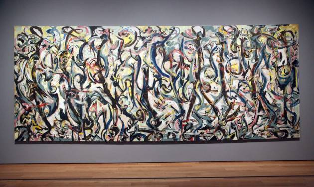 """Jackson Pollock's """"Mural,"""" 1943, as installed at the J. Paul Getty Museum in Los Angeles on Monday, March 10, 2014. The oil-on-canvas work, measuring more than 8 feet high and nearly 20 feet long, has been under wraps at the J. Paul Getty Museum for more than a year undergoing extensive restoration. The painting, owned by the University of Iowa, will be on display at The J. Paul Getty Museum for three months, from March 11 to June 1, 2014 at the Getty Center. (AP Photo/Nick Ut )"""
