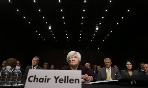 Federal Reserve Chair Janet Yellen takes her seat before she testifies about the economy at the Joint Economic Committee of Congress on Capitol Hill in Washington, Wednesday, May 7, 2014.(AP Photo/Charles Dharapak)