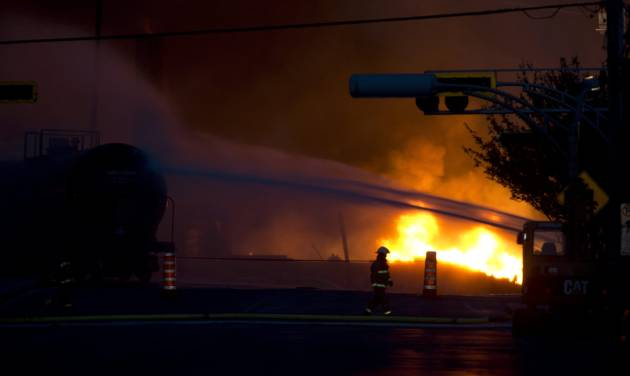 A fire keeps burns after railway cars that were carrying crude oil derailed in downtown Lac Megantic, Quebec, Saturday, July 6, 2013. (AP Photo/The Canadian Press, Paul Chiasson)