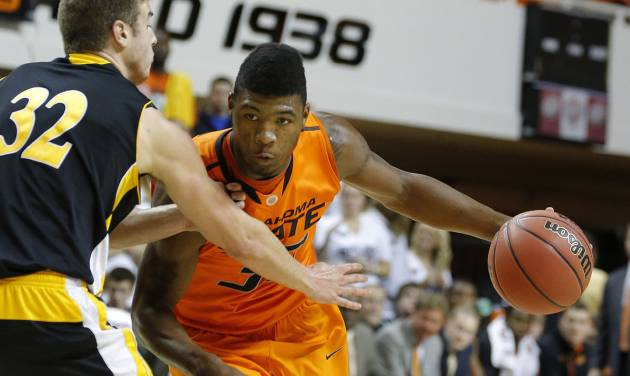 OSU BASKETBALL / OKLAHOMA STATE UNIVERSITY MEN'S BASKETBALL / KANSAS: Oklahoma State's Marcus Smart tries to get around Ottawa's Stephen Feighny during the college basketball game between Oklahoma State University and Ottawa (Kan.) at Gallagher-Iba Arena in Stillwater, Okla., Thursday, Nov. 1, 2012. Photo by Sarah Phipps, The Oklahoman