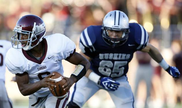 Edmond Memorial's Warren Wand is chased down by Edmond North's Joel Dixon during the high school football game between Edmond North and Edmond Memorial at Wantland Stadium in Edmond, Okla., Friday, Aug. 31, 2012. Photo by Sarah Phipps, The Oklahoman