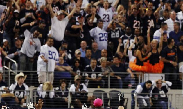 The Chicago Bears bench celebrates as outside linebacker Lance Briggs (55) returns an interception from Dallas Cowboys quarterback Tony Romo for a touchdown during the second half of an NFL football game, Monday, Oct. 1, 2012, in Arlington, Texas. (AP Photo/LM Otero)