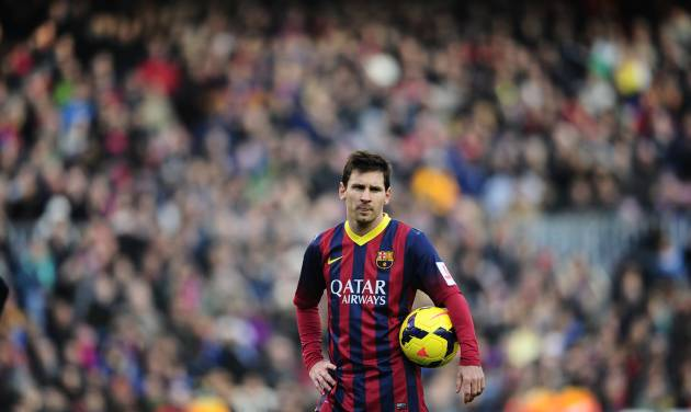 FC Barcelona's Lionel Messi, looks on against Valencia during a Spanish La Liga soccer match at the Camp Nou stadium in Barcelona, Spain, Saturday, Feb. 1, 2014. (AP Photo/Manu Fernandez)