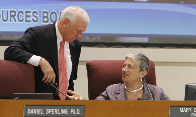 California Air Resources Board Member Ron Roberts talks with ARB chair Mary Nichols during a hearing held Thursday, Sept. 20, 2012, in Sacramento, Calif. The board took testimony from experts and the public on the the cost to businesses and consumers with the implementation of AB32, California's landmark greenhouse gas emissions law. (AP Photo/Rich Pedroncelli)