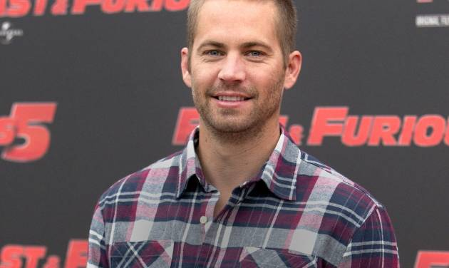 "FILE - In this April 29, 2011 file photo, actor Paul Walker poses during the photo call of the movie ""Fast and Furious 5,"" in Rome. Walker's daughter Meadow Rain Walker will live with her mother and a nanny, a court appointed attorney told a Los Angeles Superior Court commissioner during a hearing on Wednesday, May 28, 2014. Commissioner David Cowan dismissed a guardianship proceeding over the 15-year-old after hearing details about who will care for her. (AP Photo/Andrew Medichini, File)"